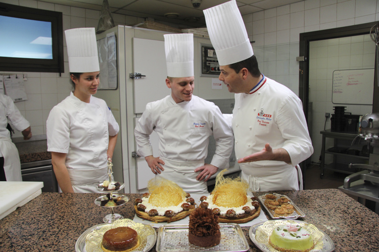 chef Christophe Muller with a selection of desserts
