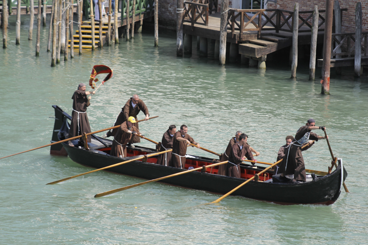 Armenian monks from San Lazzaro island in the Vogalonga - no place in their boat